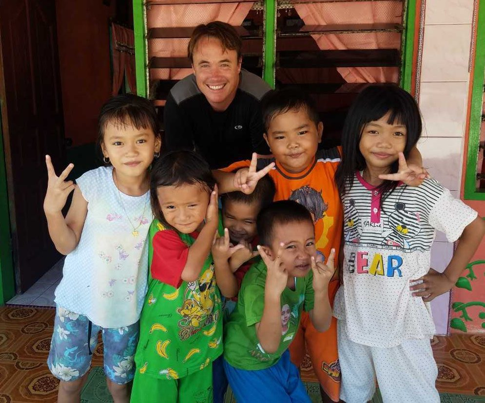 Mr. Rogers make some friends during his surf trip to Indonesia