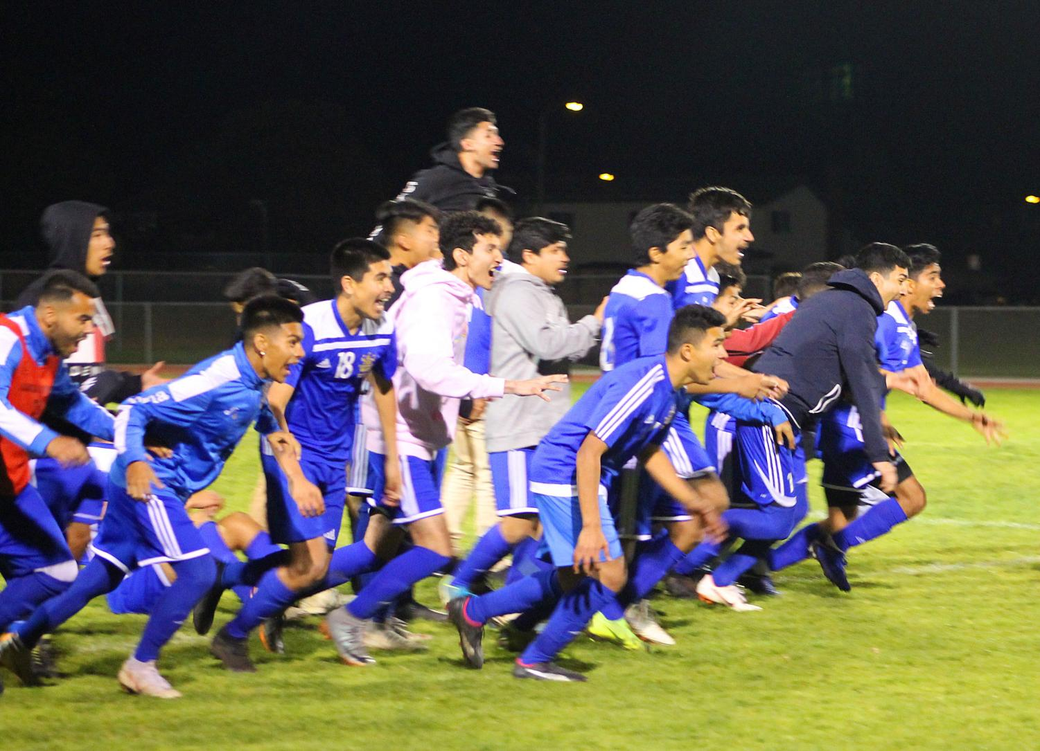 Raiders storm the field after defeating Camarillo in penalty kicks, 4-3, in the first-round CIF game