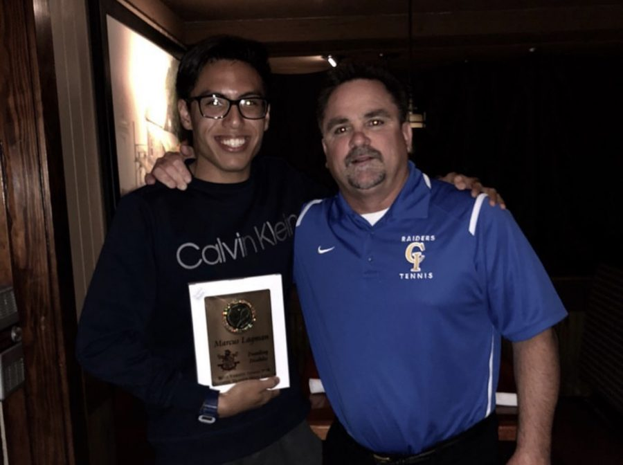 Marcus Lagman gets a tennis award from Coach Brett Zielsdorf
